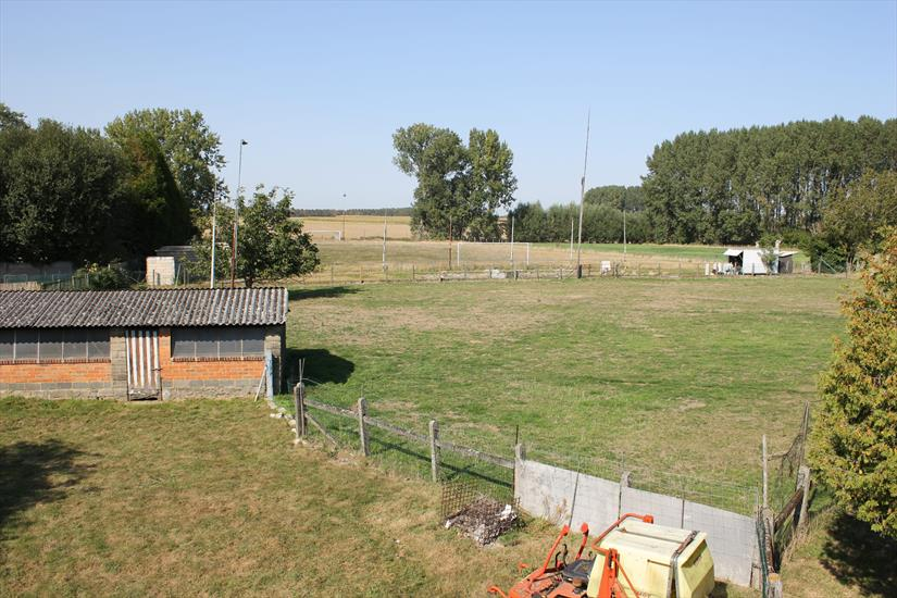 Striking property to renovate on approximately 3ha with outbuildings, football fields, meadows, pond and construction land for sale (Bavegem).
